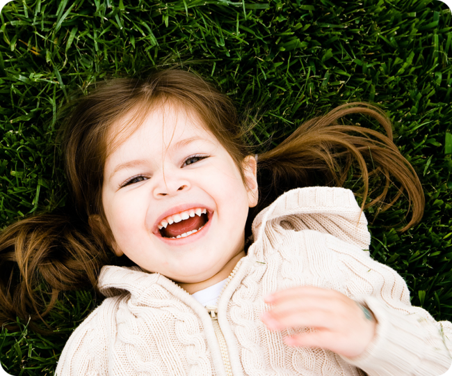 Happy Child in Grass